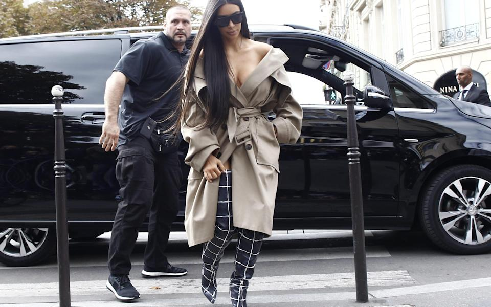 Kim Kardashian is spotted out and about in Paris, France during Paris Fashion Week just hours before the reality star was held at gunpoint in her hotel room - WENN.com