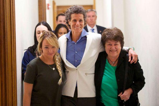 PHOTO: Bill Cosby accuser Andrea Constand, center, and supporters embrace after Cosby was found guilty in his sexual assault retrial, April, 26, 2018, at the Montgomery County Courthouse in Norristown, Pa. (Mark Makela/Pool Photo via AP)