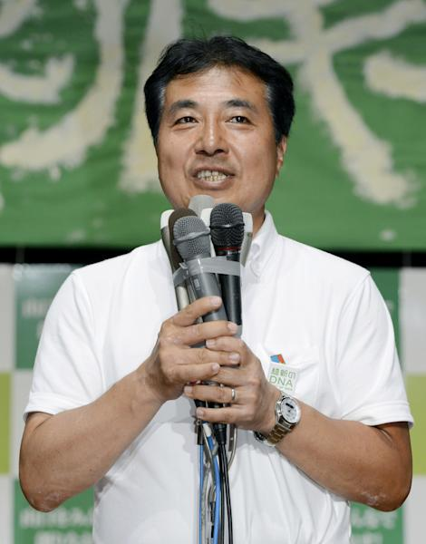 Tetsunari Iida, a candidate in Yamaguchi gubernatorial election, speaks to supporters after the regional election for the governor in Yamaguchi, southwestern Japan, Sunday, July 29, 2012. Kyodo and other Japanese media said Iida, who opposes a plan to build nuclear plant in the prefecture and nuclear power in general, was defeated by old-guard candidate Shigetaro Yamamoto on Sunday. (AP Photo/Kyodo News) JAPAN OUT, MANDATORY CREDIT, NO LICENSING IN CHINA, HONG KONG, JAPAN, SOUTH KOREA AND FRANCE