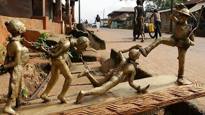 A bronze sculpture showing a scene from the colonial era in Benin City, Niger - 2004