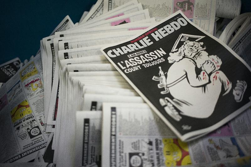The cover of an edition of French satirical magazine Charlie Hebdo marking the first anniversary of the terror attack on the magazine's offices in Paris in January 2015 (AFP Photo/MARTIN BUREAU)