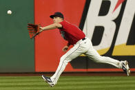 Cleveland Indians' Myles Straw catches a fly ball hit by Kansas City Royals' Andrew Benintendi in the eighth inning of a baseball game, Tuesday, Sept. 21, 2021, in Cleveland. Benintendi was out on the play. (AP Photo/Tony Dejak)