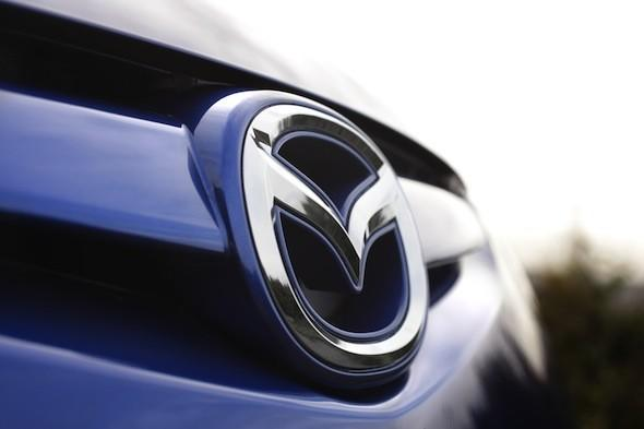 Mazda says there is no rush for hybrid tech