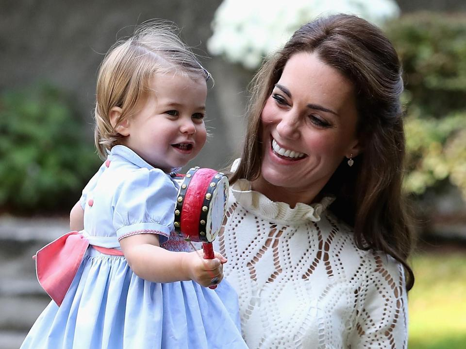 <p>Charlotte lapped up the attention at the Canadian children's party.<br><i>[Photo: PA]</i> </p>