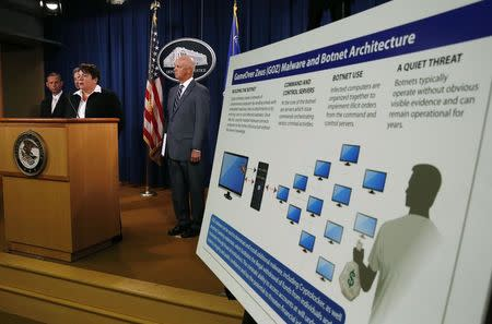 U.S. Assistant Attorney General Caldwell of the Justice Department's Criminal Division announces criminal charges and two global cyber fraud disruptions, Gameover Zeus and Cyrptolocker, at the Department of Justice in Washington