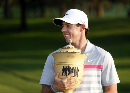 Rory McIlroy celebrates with the trophy following the final round of the WGC-Bridgestone Invitational golf tournament at Firestone Country Club - South Course on August 3, 2014. USA TODAY Sports/Joe Maiorana
