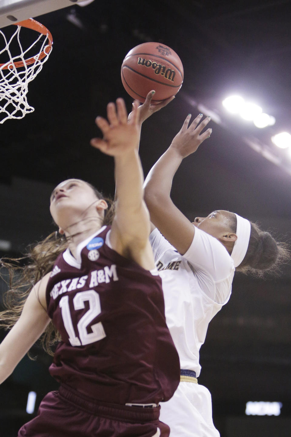 Notre Dame forward Danielle Patterson, right, shoots over Texas A&M guard Danni Williams (12) during the first half in a regional semifinal at the NCAA women's college basketball tournament, Saturday, March 24, 2018, Spokane, Wash. (AP Photo/Young Kwak)
