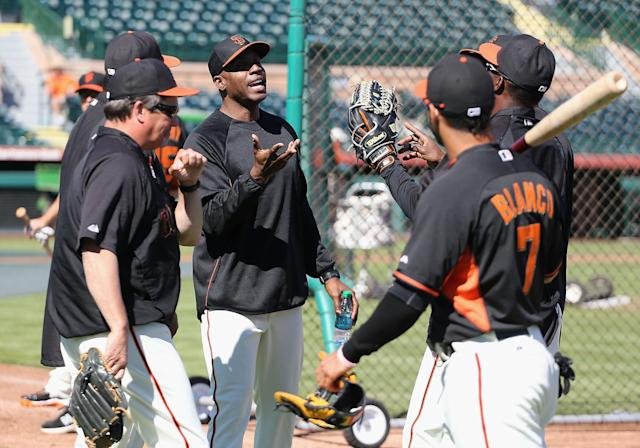 SCOTTSDALE, AZ - MARCH 10: Barry Bonds (C) of the San Francisco Giants speaks with team coaches as a special hitting coach for one week of Spring Training during batting practice at Scottsdale Stadium on March 10, 2014 in Scottsdale, Arizona. (Photo by Christian Petersen/Getty Images)