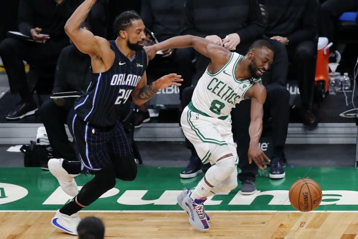 Orlando Magic's Khem Birch (24) fouls Boston Celtics' Kemba Walker (8) during the first half on an NBA basketball game, Sunday, March 21, 2021, in Boston. (AP Photo/Michael Dwyer)