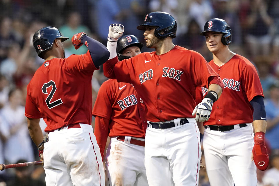 Boston Red Sox's J.D. Martinez celebrates with Xander Bogaerts (2) after hitting a three-run home run during the second inning of the team's baseball game against the Philadelphia Phillies at Fenway Park, Friday, July 9, 2021, in Boston. (AP Photo/Elise Amendola)