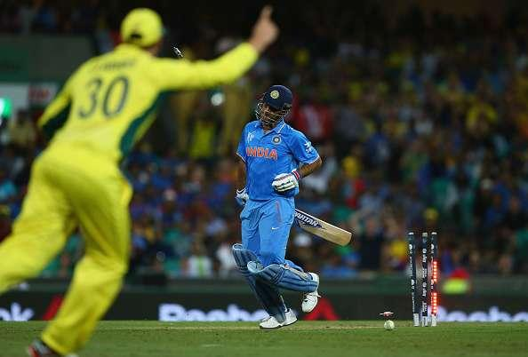SYDNEY, AUSTRALIA - MARCH 26: MS Dhoni of India is run out by Glenn Maxwell of Australia during the 2015 Cricket World Cup Semi Final match between Australia and India at Sydney Cricket Ground on March 26, 2015 in Sydney, Australia. (Photo by Ryan Pierse/Getty Images)