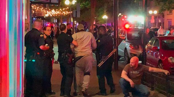 PHOTO: In this image made from video provided by Jeff Oaks, first responders help walk an injured person to safety after a deadly shooting in Dayton, Ohio, Aug. 4, 2019. (Jeff Oaks/AP)