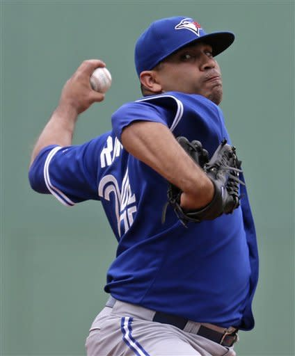 Toronto Blue Jays starting pitcher Ricky Romero delivers to the Boston Red Sox during the first inning of a baseball game at Fenway Park in Boston, Wednesday, June 27, 2012. (AP Photo/Charles Krupa)