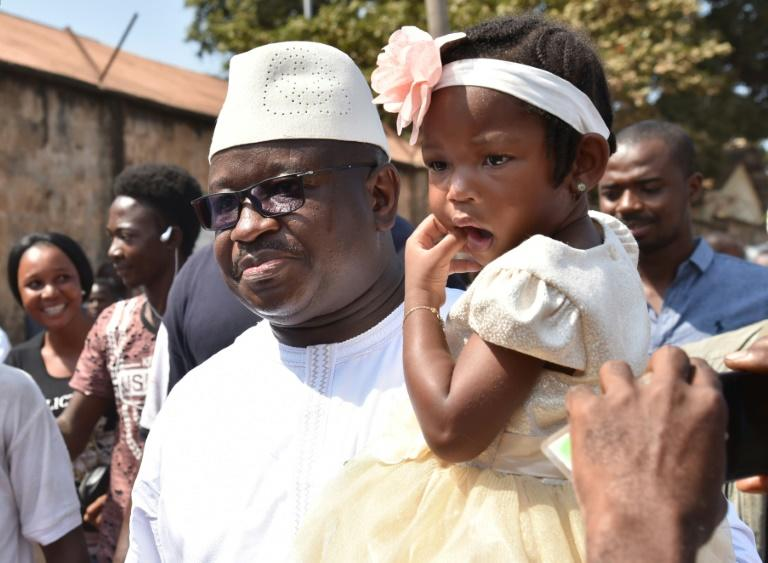 Julius Mada Bio, the candidate for the Sierra Leone People's Party, was accompanied by his daughter to the polling station