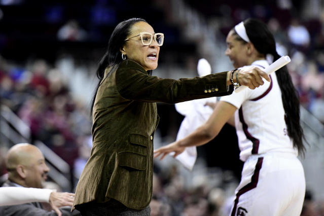 South Carolina coach Dawn Staley, left, communicates with players during the first half of an NCAA college basketball game against Arkansas, Thursday, Jan. 9, 2020, in Columbia, S.C. (AP Photo/Sean Rayford)