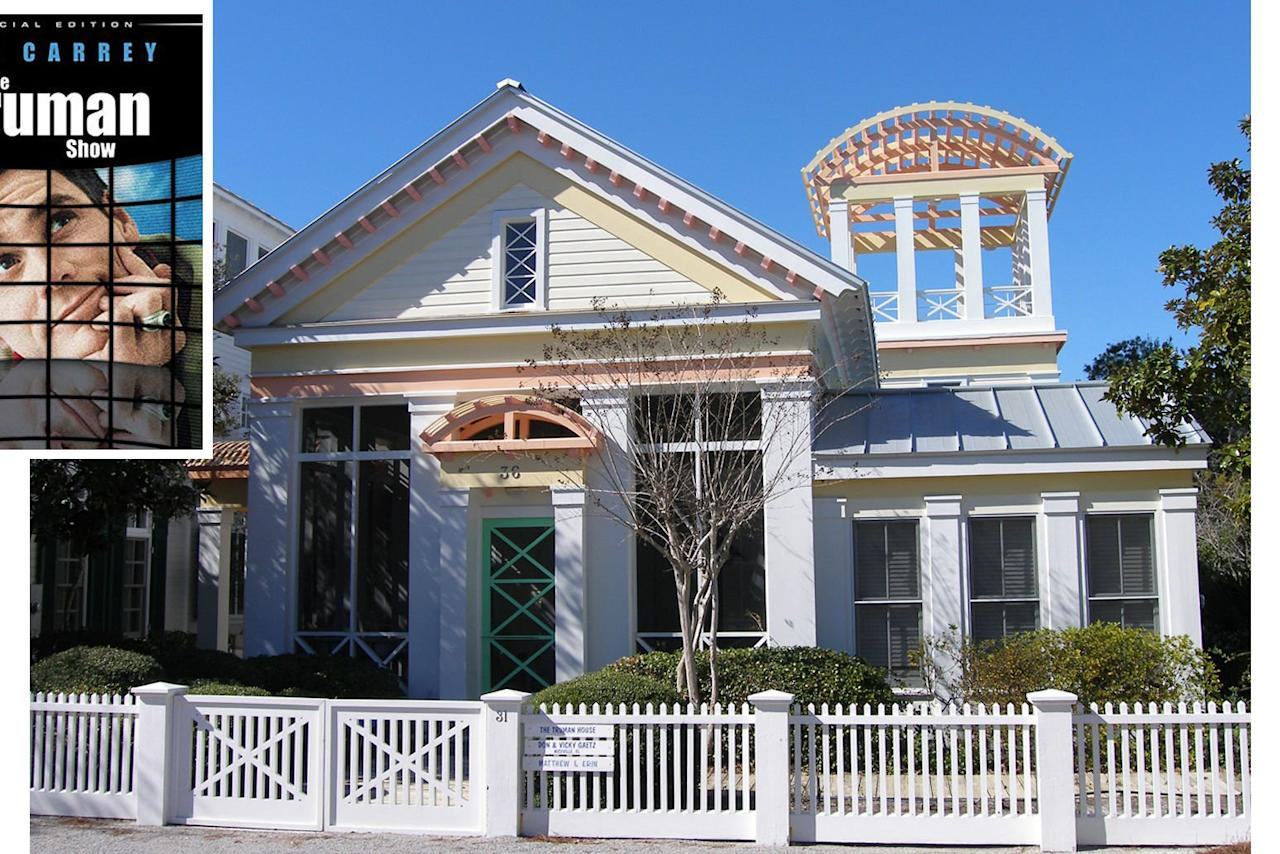 "<p>The film may have been about a make-believe world, but the house Truman Burbank called home is very much real. Situated on an unassuming side street in the picturesque town of <a href=""https://www.coastalliving.com/travel/gulf-coast/seaside-florida-travel-guide"" target=""_blank"">Seaside, Florida</a>, the home still has the same impossibly cheery paint job, including the bright front door that Truman stepped through each day. Twenty-one years after the film's release, it is still drawing tourists who love to stop outside and quote the unknowing reality star's famed line: ""Good afternoon, good evening, and good night!""</p>"