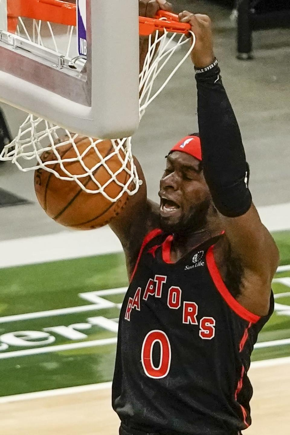 Toronto Raptors' Terence Davis dunks during the first half of an NBA basketball game against the Milwaukee Bucks Tuesday, Feb. 16, 2021, in Milwaukee. (AP Photo/Morry Gash)
