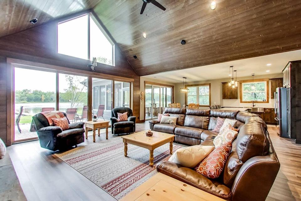 """<h2>Ivy Lane Lake House </h2><br><br><strong>Location:</strong> Crosslake, Minnesota<br><strong>Sleeps:</strong> 16+<br><strong>Price Per Night:</strong> $446<br><em>Check availability <strong><a href=""""https://airbnb.pvxt.net/dPdPk"""" rel=""""nofollow noopener"""" target=""""_blank"""" data-ylk=""""slk:here"""" class=""""link rapid-noclick-resp"""">here</a></strong></em><br><br>""""Ivy Lane is a place for friends and family to gather and make memories while enjoying the many amenities the area has to offer. Ivy Lane is situated on the Whitefish chain which is part of a 14 chain of lakes in the Brainerd Lakes area. The Whitefish chain is known for boating, water sports, fishing, and its many scenic views. There are many restaurants as well as nearby golfing, shopping, ATV, snowmobiling, and bike trails. There are endless activities to be enjoyed year-round.""""<br><br>"""