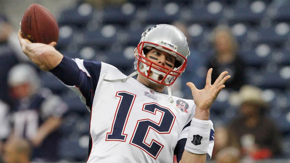 Mandatory Credit: Photo by Donna Mcwilliam/AP/Shutterstock (9274107ab)New England Patriots' quarterback Tom Brady (12) warms up before the NFL football game against the Houston Texans NFL football game in HoustonPatriots Texans Football, Houston, USA - 3 Jan 2010.