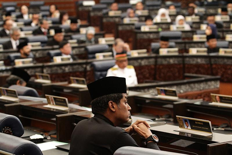Khairy Jamaluddin sits alone after Opposition lawmakers from Barisan Nasional (BN) and PAS stormed out of the Dewan Rakyat in Parliament, July 16, 2018. — Picture by Miera Zulyana