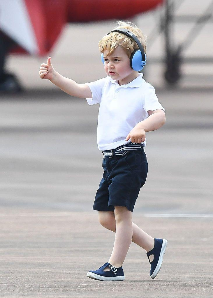 <p>George gave a thumbs up as he got to look at more aircrafts during a visit to The Royal International Air Tattoo at RAF Fairford in July 2016. </p>