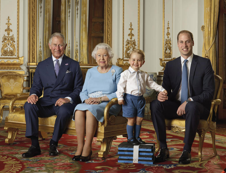 FILE - In this file handout photo provided by Buckingham Palace and released in 2016, Britain's Queen Elizabeth, Prince Charles, Prince William and Prince George pose for a photo to mark the Queen's 90th birthday, in the White Drawing Room at Buckingham Palace, London. Buckingham Palace have released a photo of the Queen and the next three in line to the throne to mark the new year. This is only the second time such a portrait has been released, the first was in April 2016 to celebrate Her Majesty's 90th birthday. (Ranald Mackechnie/Buckingham Palace via AP)