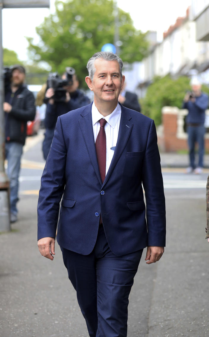 Democratic Unionist Party members Edwin Poots leaves the party headquarters in east Belfast after voting took place to elect a new leader on Friday May 14, 2021. Edwin Poots and Jeffrey Donaldson are running to replace Arlene Foster. (AP Photo/Peter Morrison)