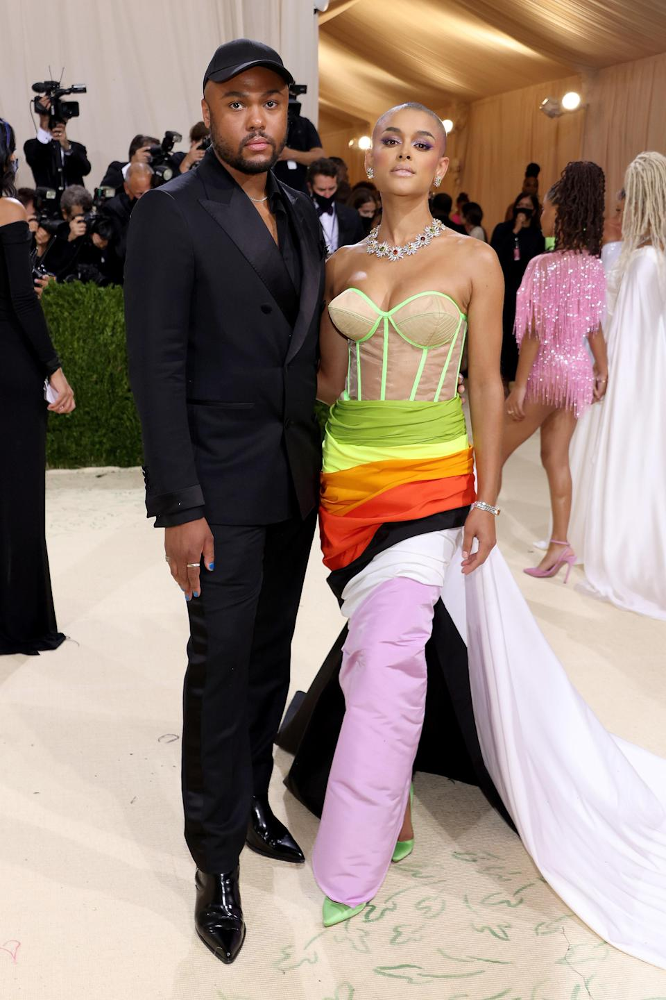 New <em>Gossip Girl</em> star Jordan Alexander looked breathtaking in an LGBTQ+-inspired flag dress by Louisana-born and Brooklyn-based designer Christopher John Rogers, with whom she walked up the iconic Met stairs she knows so well.