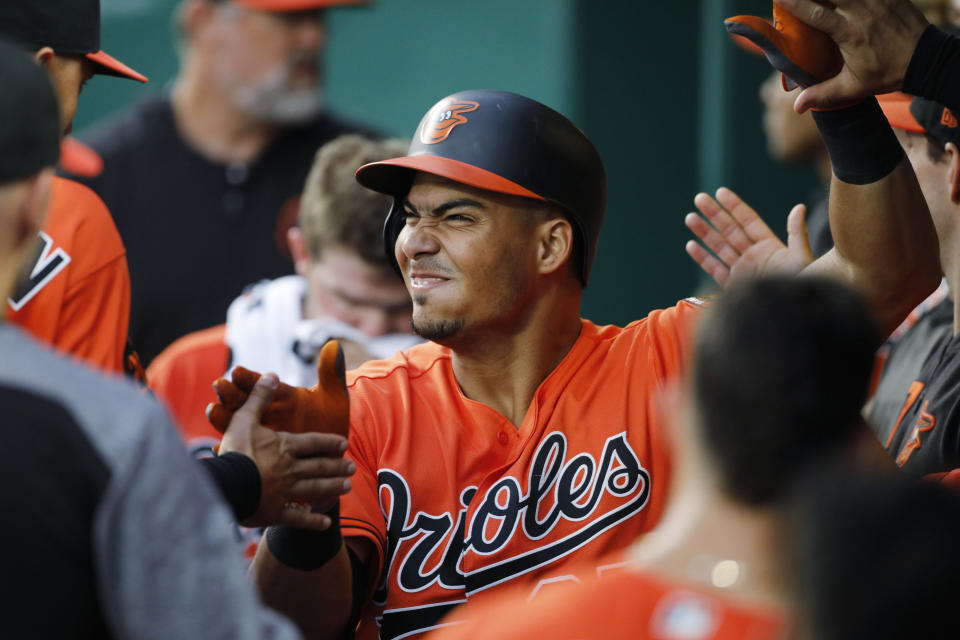 Baltimore Orioles' Anthony Santander reacts as he is congratulated in the dugout after hitting a home run in the fourth inning of a baseball game against the Kansas City Royals at Kauffman Stadium in Kansas City, Mo., Saturday, Aug. 31, 2019. (AP Photo/Colin E. Braley)