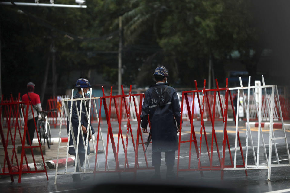 Police security forces stand guard at roadblocks leading to Martyrs' Mausoleum in Yangon, Myanmar Monday, July 19, 2021. Myanmar's military-installed government and those seeking to topple it on Monday marked the anniversary of the assassination of independence hero Gen. Aung San, who was also the father of the country's recently ousted leader, Aung San Suu Kyi. (AP Photo)
