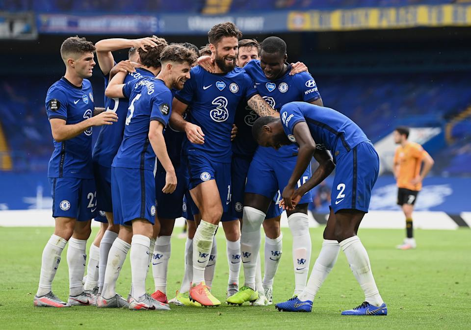 Olivier Giroud celebrates with teammates after scoring his team's second goal.