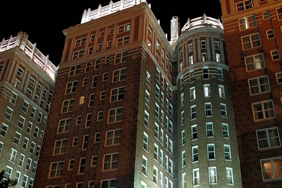 "<p>Two towers and three wings comprise this Oklahoma City hotel, which first opened in 1911. Several NBA basketball teams that stayed at the hotel have cited instances of odd happenings that they credit to the <span class=""redactor-unlink"">hotel being haunted</span> by a former maid, ""Effie."" The Knicks even blame their 2010 loss on the haunting.<br></p><p><strong>EXPLORE NOW:</strong> <a href=""https://www.tripadvisor.com/Hotel_Review-g51560-d635098-Reviews-The_Skirvin_Hilton_Oklahoma_City-Oklahoma_City_Oklahoma.html"" rel=""nofollow noopener"" target=""_blank"" data-ylk=""slk:The Skirvin Hilton"" class=""link rapid-noclick-resp"">The Skirvin Hilton</a></p><p><em>Image via <a href=""https://www.flickr.com/photos/rutlo/3859817221/in/photolist-dYykxp-6T5zbM"" rel=""nofollow noopener"" target=""_blank"" data-ylk=""slk:MATTHEW RUTLEDGE"" class=""link rapid-noclick-resp"">MATTHEW RUTLEDGE</a>/Flickr</em></p>"