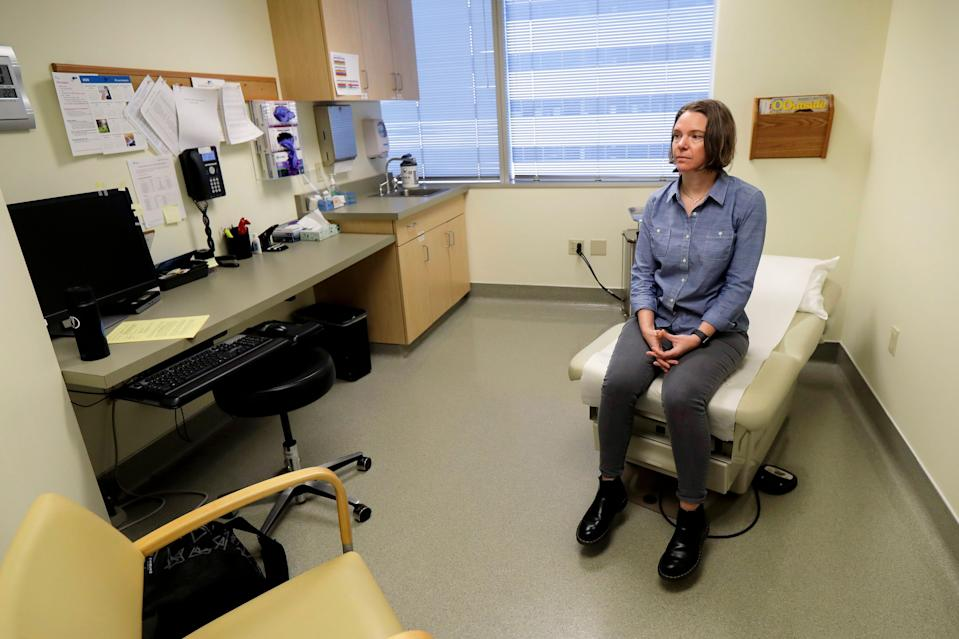 Jennifer Haller waits in an exam room to be the first given a shot in the Phase 1 trial of a coronavirus vaccine on March 16, 2020.