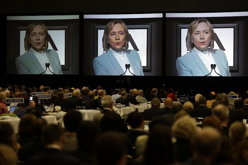 FILE - This Aug. 12, 2013 file photo shows delegates listening as former Secretary of State Hillary Rodham Clinton addresses the American Bar Association Annual Meeting in San Francisco. As Hillary Rodham Clinton privately weighs a second White House run, pieces of the Democratic establishment are beginning to fall into place publicly to help a possible candidacy. Several super political action committees are collectively acting as a de facto campaign organization to ensure she's ready to compete aggressively if she decides to try again to become the first woman president.Clinton spoke about maintaining the Voting Rights Act and received a medal from the association. (AP Photo/Eric Risberg, File)