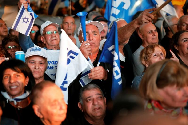 Supporters of Israeli PM Netanyahu take part in a protest supporting Netanyahu after he was charged in corruption cases, in Tel Aviv