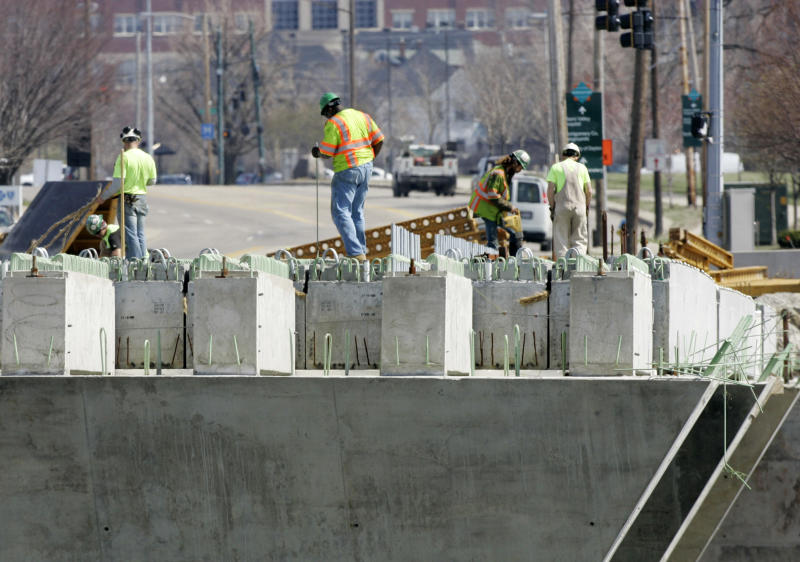 FILE - This March 18, 2009 file photo shows workmen continuing construction on a bridge over the Miami River in Dayton, Ohio. Here are a few items that have been largely missing in the presidential campaign: planes, trains, roads and bridges. Most of the nation's transportation network was built in the last century, and in some places dates back to the 1800s. Our aging highways, bridges, trains and buses are frequently in need of repair or replacement, and no longer can handle peak traffic demands. More than 140,000 bridges are structurally deficient or obsolete. And the problem will only worsen as the nation's population grows.  (AP Photo/Mark Duncan, File)