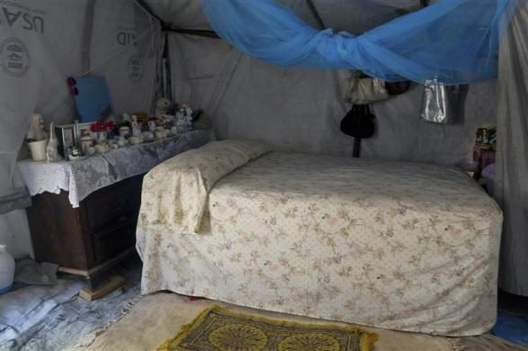 A view of the tent home of earthquake survivor Aline Deispeines, 44, located near the headquarters of her Organization of Dedicated Women in Action in Port-au-Prince, March 4, 2012.