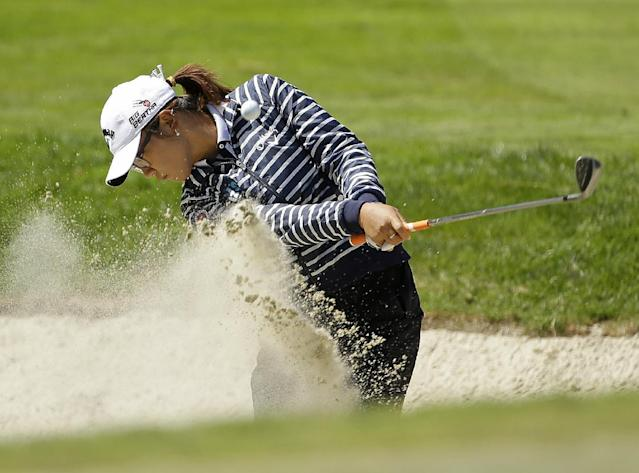 Lydia Ko, of New Zealand, hits out of a bunker up to the sixth green of the Lake Merced Golf Club during the third round of the Swinging Skirts LPGA Classic golf tournament on Saturday, April 26, 2014, in Daly City, Calif. (AP Photo/Eric Risberg)