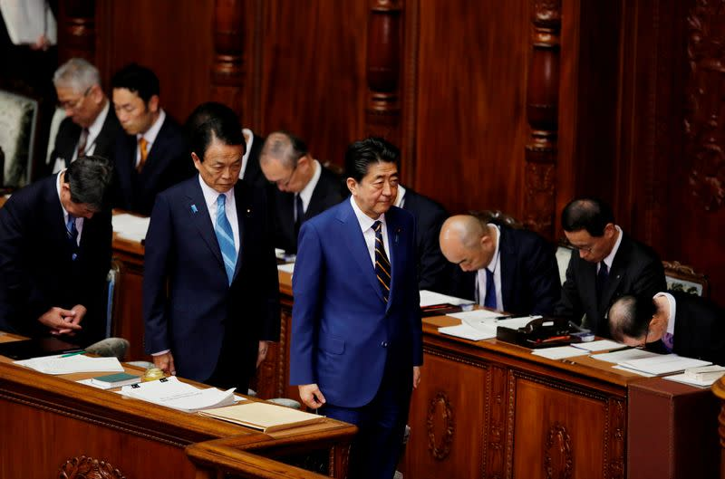 Japanese Prime Minister Shinzo Abe and Finance Minister Taro Aso attend the regular session of parliament in Tokyo
