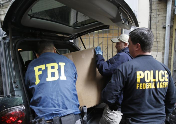 Federal agents load boxes of evidence into a car following a search of a Chinatown fraternal organization Wednesday, March 26, 2014, in San Francisco. A California state senator was arrested Wednesday during a series of raids by the FBI in Sacramento and the San Francisco Bay Area, authorities said. An FBI spokesman confirmed the arrest of State Sen. Leland Yee, but declined to discuss the charges, citing an ongoing investigation. (AP Photo/Eric Risberg)