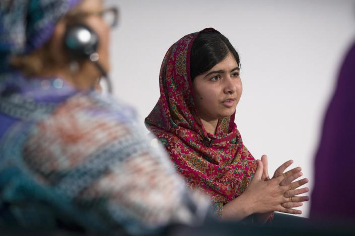 Pakistani schoolgirl activist Malala Yousafzai speaks at the 'Girl Summit 2014' at the Walworth Academy in London July 22, 2014. Britain is to make it compulsory for teachers and health workers to report cases of female genital mutilation (FGM), Prime Minister David Cameron said on Tuesday. The government, which is hosting a London summit on FGM and forced marriage, will also announce a range of other measures aimed at bringing an end to both practices in Britain and abroad, Cameron's office said in a statement. REUTERS/Oli Scarff/Pool (BRITAIN - Tags: POLITICS SOCIETY)