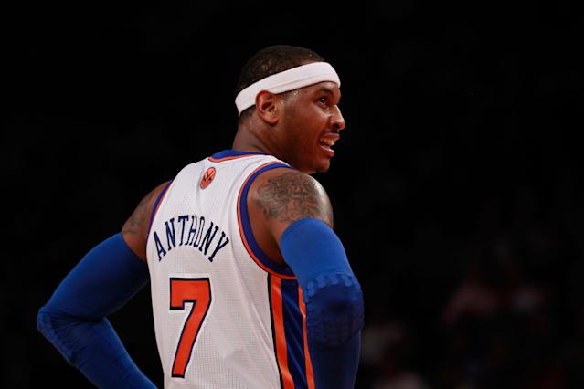 NEW YORK, NY - MARCH 14: Carmelo Anthony #7 of the New York Knicks looks on against the Portland Trail Blazers at Madison Square Garden on March 14, 2012 in New York City. NOTE TO USER: User expressly acknowledges and agrees that, by downloading and/or using this Photograph, user is consenting to the terms and conditions of the Getty Images License Agreement. (Photo by Chris Trotman/Getty Images)