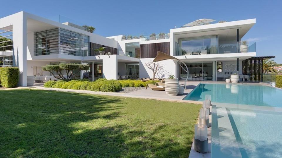 """<p>Dreaming of your own villa? This eight-bedroom property might cost €12.5 million, but it certainly has a lot to offer. Some of our favourite features include the heated infinity pool, air conditioning, underfloor heating, CCTV, smart <a href=""""https://www.housebeautiful.com/uk/decorate/kitchen/a37177632/dream-kitchen-features/"""" rel=""""nofollow noopener"""" target=""""_blank"""" data-ylk=""""slk:kitchen"""" class=""""link rapid-noclick-resp"""">kitchen</a> with Gaggenau appliances and a rooftop lounge. </p><p>This property is currently on the market for €12,500,000 with Waratah Properties, Almancil, via <a href=""""https://www.rightmove.co.uk/properties/74579052#/"""" rel=""""nofollow noopener"""" target=""""_blank"""" data-ylk=""""slk:Rightmove"""" class=""""link rapid-noclick-resp"""">Rightmove</a>. </p>"""