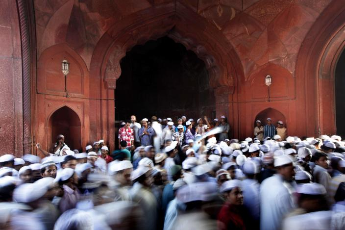 Muslims leave after offering prayers at the Jama Masjid mosque during Eid al-Fitr in New Delhi, India, Wednesday, Aug. 31, 2011. Eid al-Fitr is a holiday marking the end of the holy month of Ramadan, which is observed by millions of Muslims around the world. (AP Photo/Rajesh Kumar Singh)