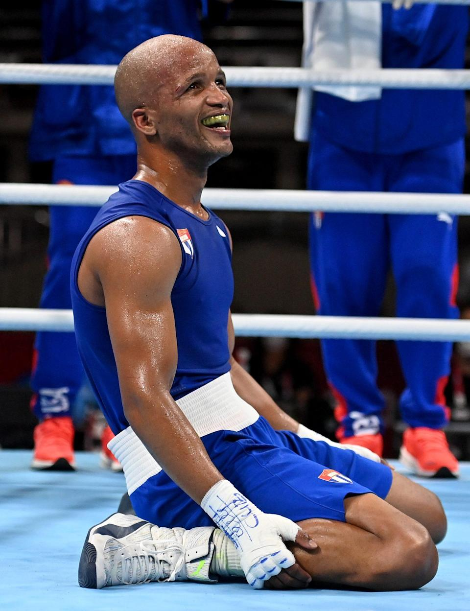 <p>Team Cuba's Roniel Iglesias falls to his knees after winning the gold medal against Pat McCormack of Team Great Britain during the Men's Welter (63-69kg) final at Kokugikan Arena on August 3.</p>