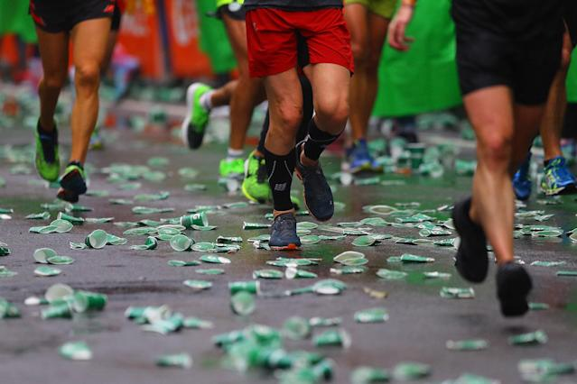 <p>Runners step on used water cups discarded on the street during the 2017 New York City Marathon, Nov. 5, 2017. (Photo: Gordon Donovan/Yahoo News) </p>