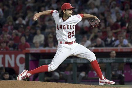Jun 18, 2018; Anaheim, CA, USA; Los Angeles Angels relief pitcher Noe Ramirez (25) delivers a pitch in the fourth inning against the Arizona Diamondbacks at Angel Stadium of Anaheim. Mandatory Credit: Kirby Lee-USA TODAY Sports