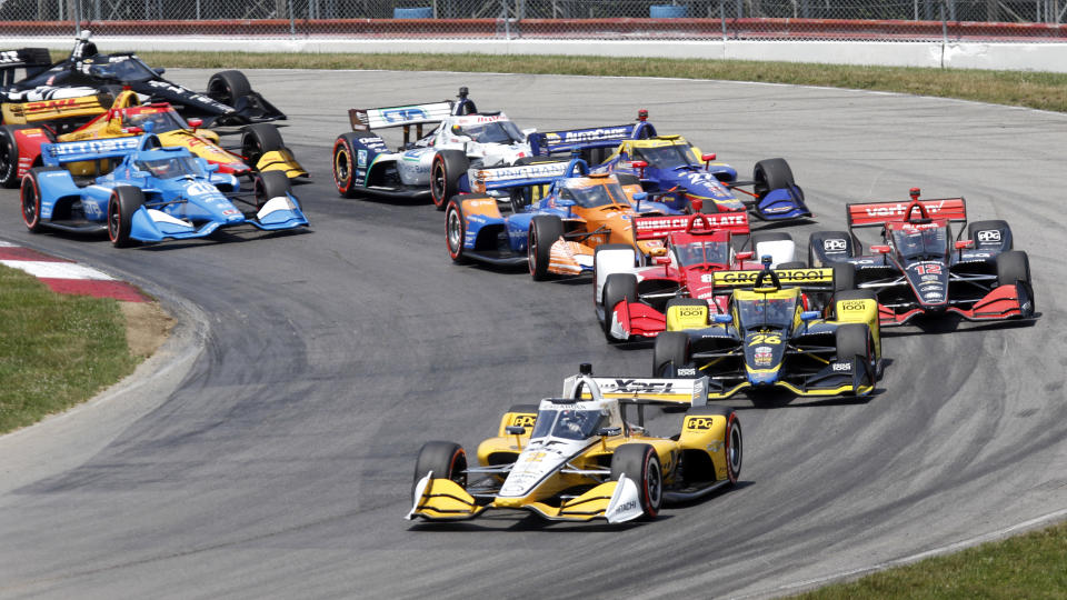 Josef Newgarden leads the field after taking the green flag at the start of an IndyCar race at Mid-Ohio Sports Car Course in Lexington, Ohio, Sunday, July 4, 2021. Newgarden snapped his streak of late race misfortunes Sunday to win for the first time this season, earning the first IndyCar victory of the year for Team Penske on the same weekend the storied organization celebrated the 50th anniversary of its first win. (AP Photo/Tom E. Puskar)