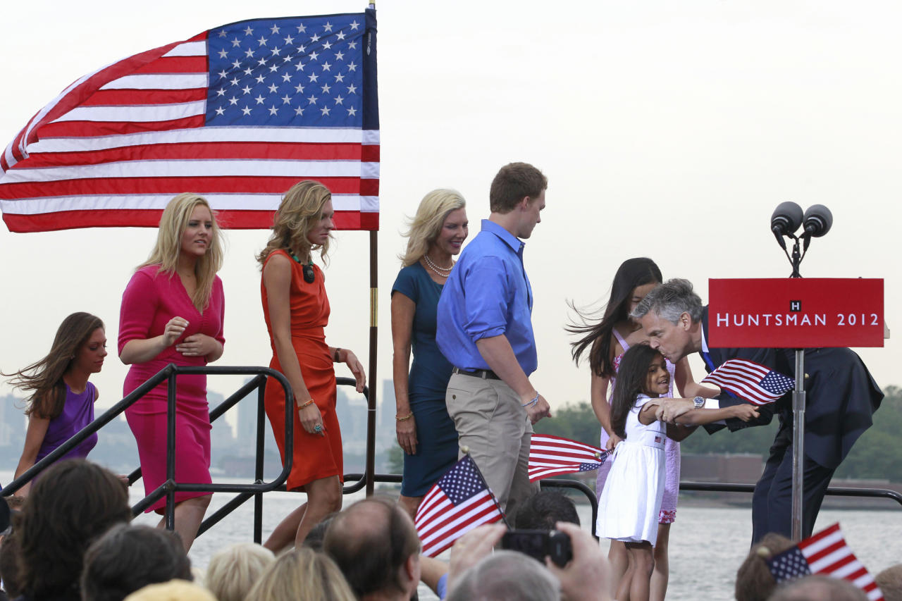 Republican presidential candidate, former Utah Gov. Jon Huntsman, right, gives a kiss to his daughter, as his family arrives, after he announced his bid, Tuesday, June 21, 2011, at Liberty State Park in Jersey City, N.J. (AP Photo/Julio Cortez)