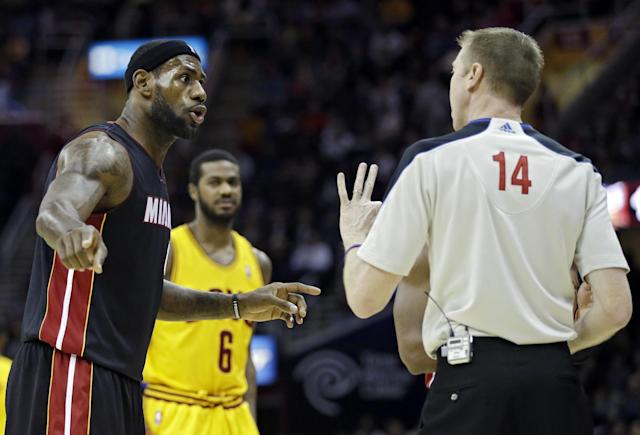 Miami Heat's LeBron James, left, argues with referee Ed Malloy (14) after a three-second violation call in the first quarter of an NBA basketball game against the Cleveland Cavaliers Wednesday, Nov. 27, 2013, in Cleveland. (AP Photo/Mark Duncan)
